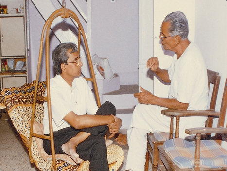 Guruji teaching to Mr.Ashok Sanghavi